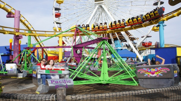 The recently refurbished Inkie's Scrambler is introduced at Pacific Park on the Santa Monica Pier in Santa Monica, Calif., on Monday, March 25, 2013. The restored ride now sports a shiny new chrome finish, brightly colored period decals and detailed lighting. The 12-car fast-paced swirling ride takes guests on a series of roundabout moves and sidesplitting rotations of more than 11 revolutions per minute. Inkie's Scrambler debuted at Pacific Park in 2000 as a family-fun ride for both parents and children that accommodates up to three riders per car. (Photo Courtesy of Pacific Park on the Santa Monica Pier)